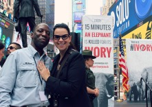 Director Jimmiel J. Mandima of the African Wildlife Foundation and Christina LaMonica in Times Square. for the second Ivory Crush on American soil in U.S. history.